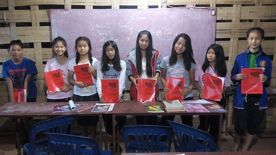 Some students with their new grammar books