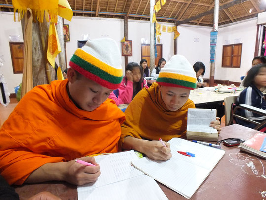 Local monks attending English class