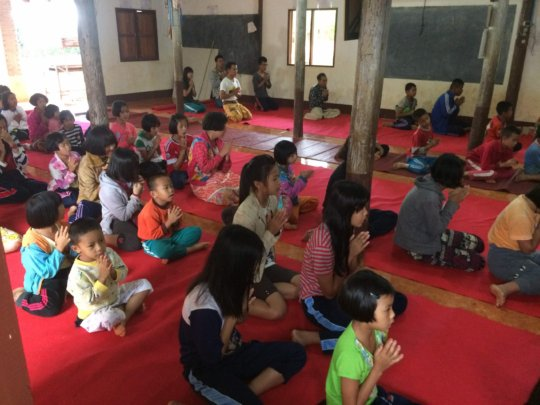 The youth of the camp at the local Buddhist temple