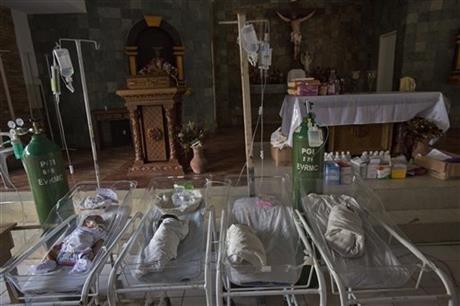 Newborns in a chapel