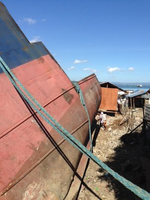 Typhoon blown ship being dismantled in Tacloban