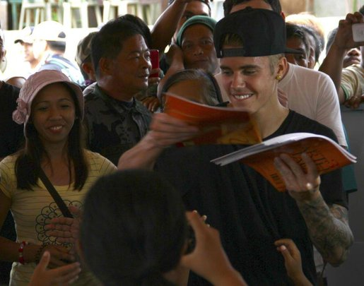 A belieber hands out some of the books