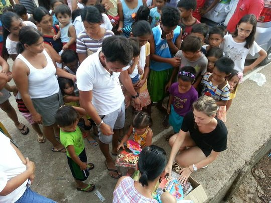 Handing out books in Coron, Palawan