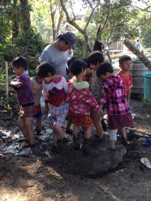 Kachin students making bricks for their school