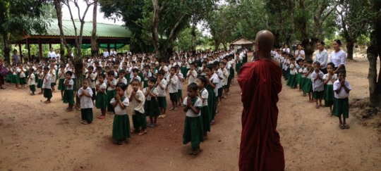 Morning assembly with head monk