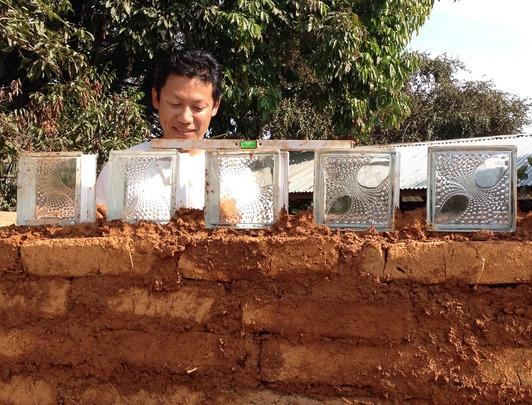 Happy director of new mud kindergarten school