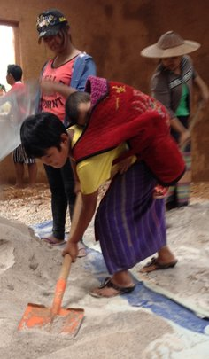 Kachin girl working with baby on her back