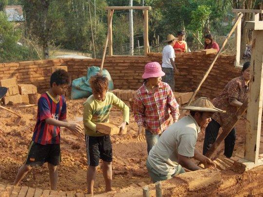 Community members working to build school