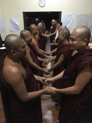 Monks and nuns closing circle for learning trip
