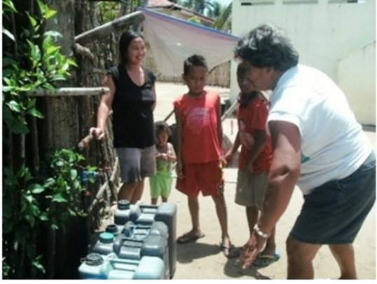 Residents of Balud using their new water tap