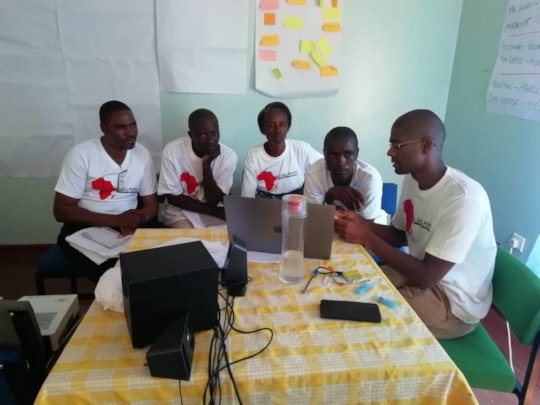 One of our volunteer doctors teaching some CHWs