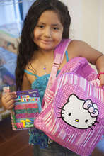A new backpack brings big smiles to a little girl