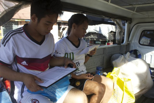 The coaches being transported across Tacloban