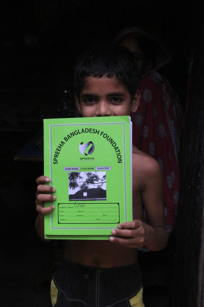 Spreeha student shows off his notebook