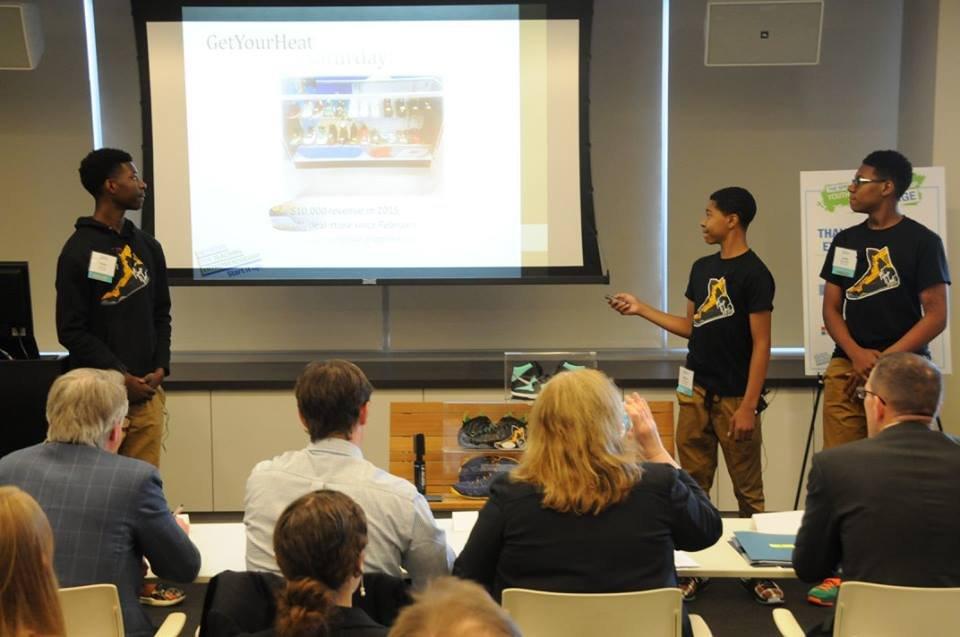 the GetYourHeat team presenting their business