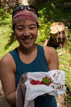 Yuki (Japan) with wild strawberries on Alpine hike