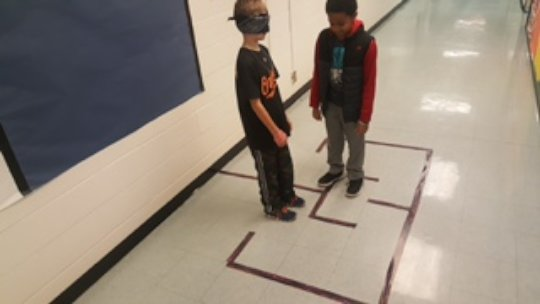 Students using Coding Directions to Navigate Maze