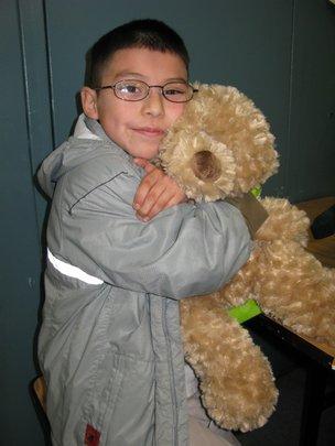 A boy bonds with his stuffed bear