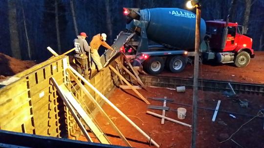 Concrete Mixer Pours Footings for New Building