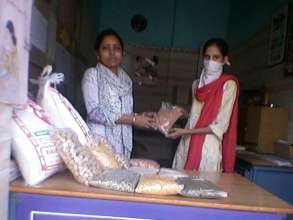 Patient receiving nutrition food from Project