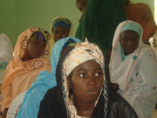 Women listening in on at the outreach