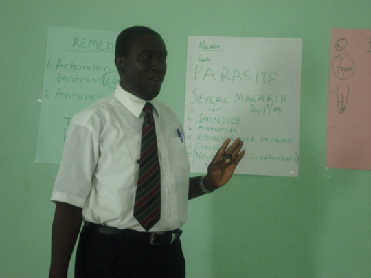 One of our outreach doctor explaining malaria