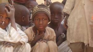 Children listening to a talk on sleeping under ITN
