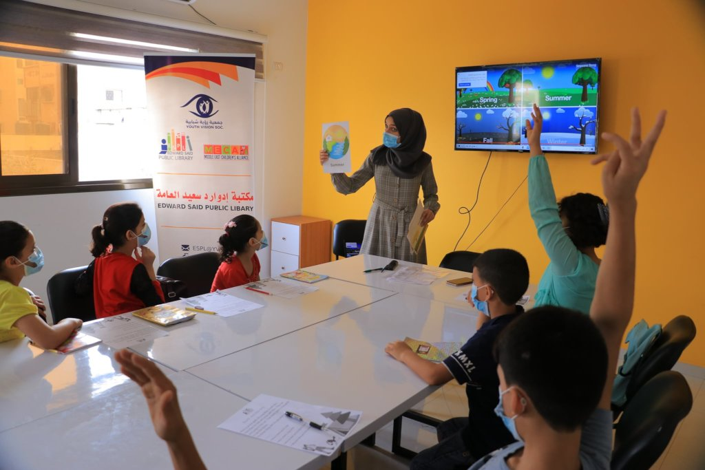 "Children with their tutor in the ""English CORNER"""