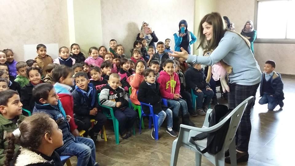 Story time in Askar Refugee Camp