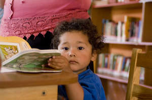 A new reader in the library (Zacualpa, Guatemala)