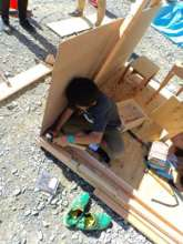 A carpenter making a house