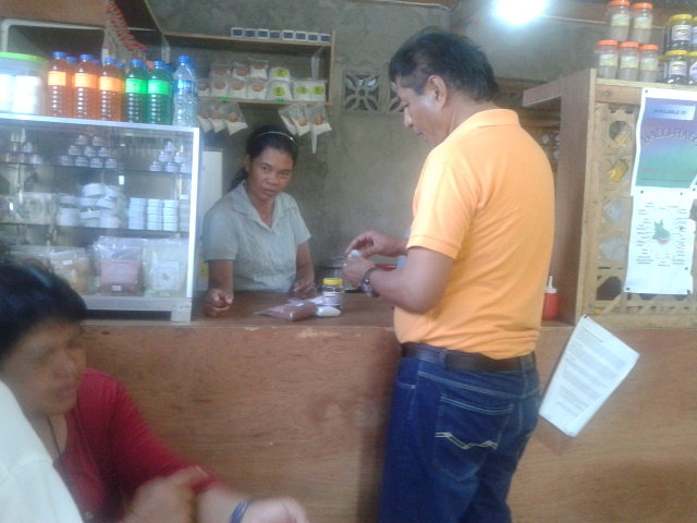 customer buying herbal products at the store