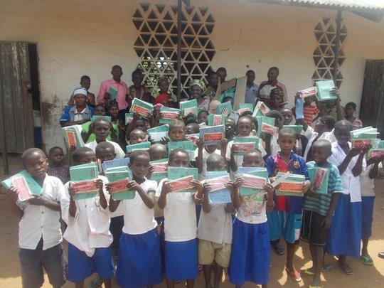 Rwenena students display math kits and notebooks