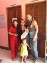 Celebrating new baby with volunteers Rina & Clark