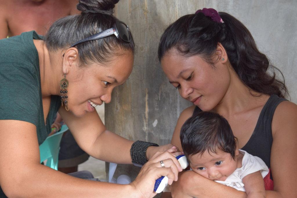 Rina at home visit, checking up mother and baby
