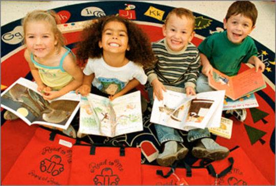 RAR kids receiving their new books & new red bags!