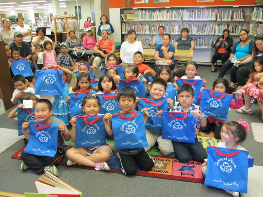 The full graduating class with their new blue bags