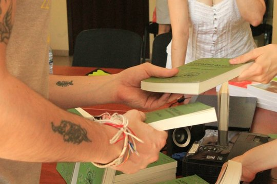 Giving out books to the attendees, Ozurgeti, July