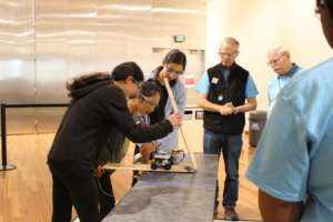 A team tests their device for the judges