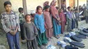 Children receiving materials to rejoin schools