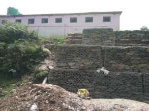 Gabion supporting the school toilet after lanslide