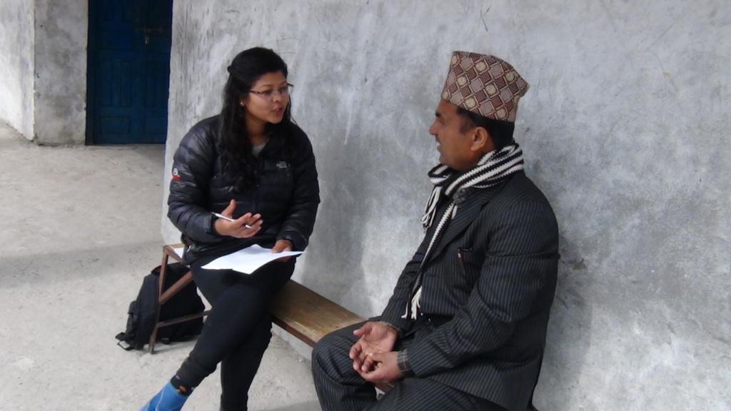 Sumi taking feedback from teacher in Kolti