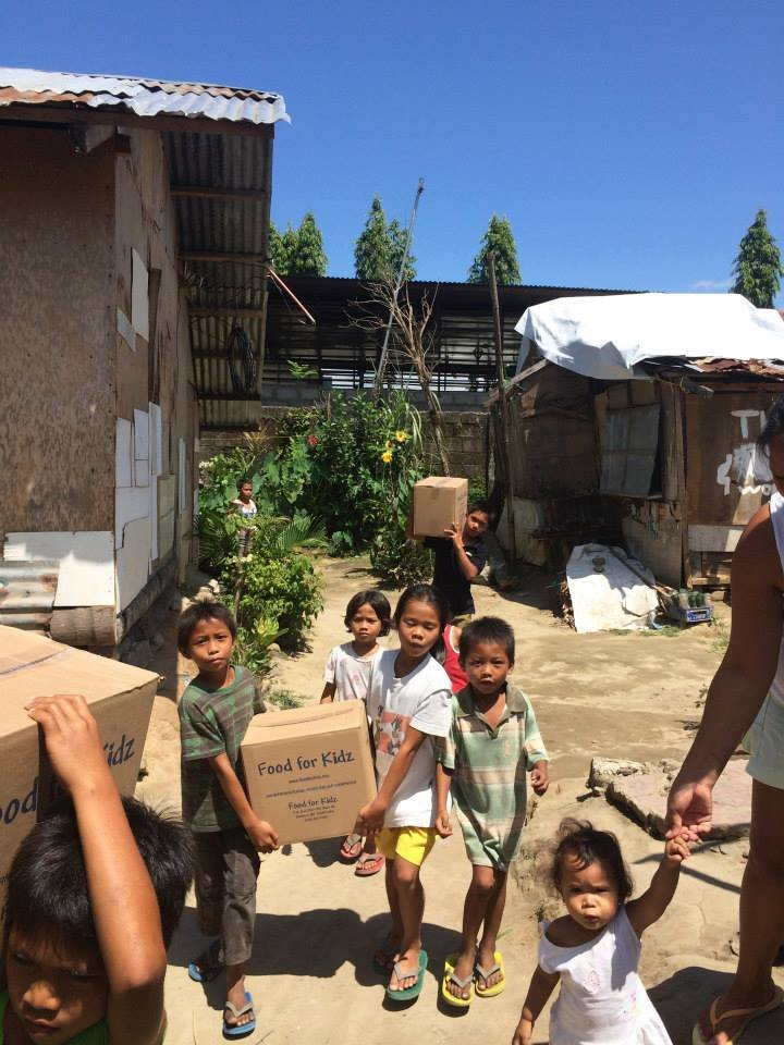 Children carrying meals to their families