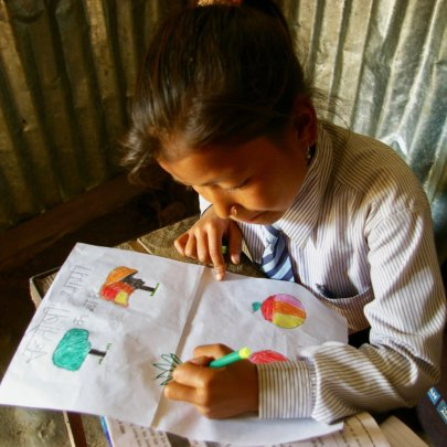 Third grade student at Deurali Primary School