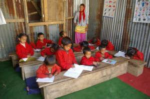 Saptamai students with ETC-provided desks/supplies