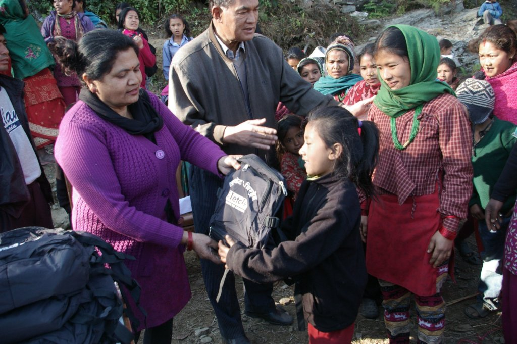 ETC-Nepal staff distributing school supplies