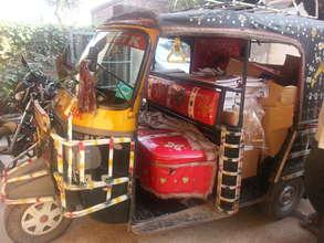 Rickshaw delivering books
