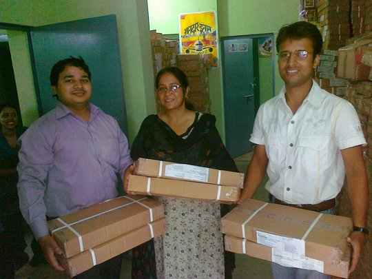 Our team delivering books to schools