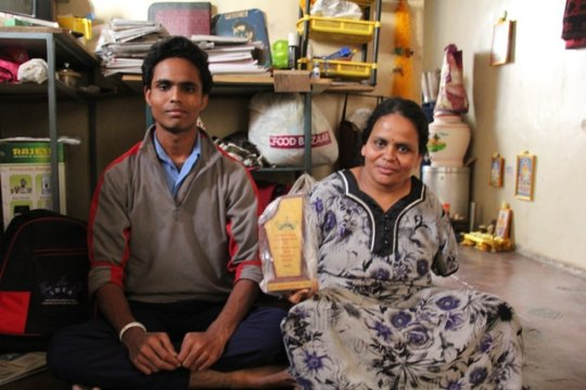 Akash and his mother at their home