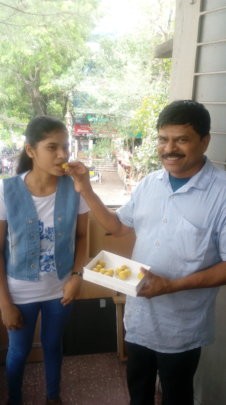 Sandhya celebrating with her father